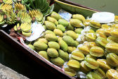 Star apple in the floating market — Stock Photo