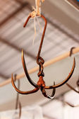 Steel four lobes hanger, use for hang meat or pork in local mark — Stock Photo