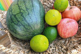 Fruits in rattan basket — Stock Photo