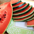 Watermelon fruit sliced pieces on wooden floor. — Stock Photo #41772451