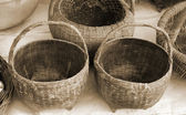 Old wicker basket at market — Stock Photo