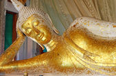 Reclining Buddha gold statue face,Thailan — Stock Photo