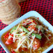 Papaya salad in a dish — Stock Photo