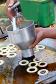 Making donut fried in a pan — Stok fotoğraf