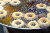 Making donut fried in a pan — Foto Stock