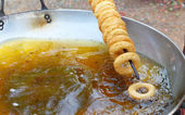Making donut fried in a pan — Stok fotoğraf