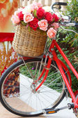 Beautiful of rose artificial flowers in vintage bicycle — Foto Stock