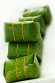 Sausage in banana leaves. — Stockfoto