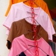 Shop shirts colorful fabric hanging on a rack. — Stock Photo #44980851