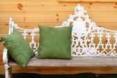 Green cushions on vintage chair. — Stock Photo