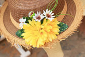 Artificial flowers the hat attached  — Stock Photo