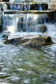 Waterfall and rock — Stock Photo