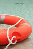 Ring buoy in the swimming pool. — Stock Photo