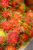 Sweet fruits rambutan in the market — Stock Photo