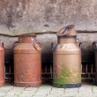 Churns against a wall — Stock Photo