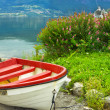 Boat on the beach of Norwegian village Olden - Stock Photo