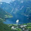 Cruise ship in Geiranger, Norway - Stock Photo