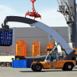 Reach stacker in container terminal - Stock Photo