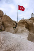 Turkish flag in the fortress Uchisar, Cappadocia, Turkey — Stock Photo