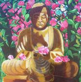 Buddha with flowers in the background — Stock Photo
