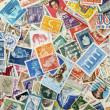 Different stamps as a background — Stock Photo