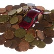 Car under a pile of coins — Stock Photo