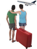 Young couple with suitcase waiting for delayed passenger plane — Stock Photo