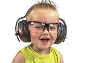 Toddler sitting with headphones on his head on a white backgroun — Stock Photo