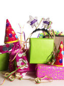A stack of colorful birthday presents — ストック写真