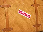 Uma mala de viagem com um texto frágil — Fotografia Stock