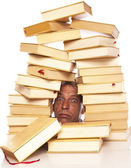 Man with head between books on a white background — Stock Photo