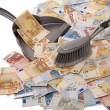 Many euro banknotes with broom and dustpan — Stock Photo #34913745