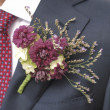 Flower corsage on a man's suit — Stock Photo #34913393
