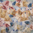 Euro banknotes as a background — Stock Photo