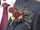 Flower corsage on a man's suit — Stock Photo