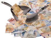 Many euro banknotes with broom and dustpan — Stock Photo