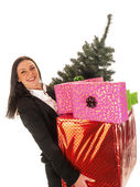 Beautiful young business woman with gifts — Stock Photo