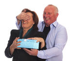 Attractive husband surprises his wife with a gift — Stock Photo