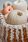 Pastel cotton skeins in a basket — Stock Photo
