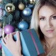 Christmas blonde woman with a present — Stock Photo #40556253