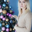 Stockfoto: Christmas blonde womhanging ball