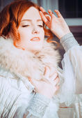 Redheaded bride basking on the winter sun — Stock Photo
