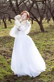 Redheaded bride basking in the winter sun — Stock Photo