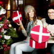 Young couple opening presents — Stock Photo