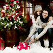 Young couple opening presents — Stock Photo #41210791