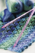 Knitting in blue and green tones — Stock Photo