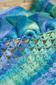 Crocheting in blue and green tones and skeins piled together — Foto Stock