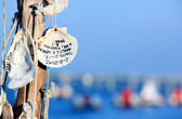Shells hanging charms with written — Stock Photo