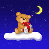Teddy Bear with gift — Stock Photo