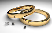 Golden wedding rings with diamond — Stock Photo